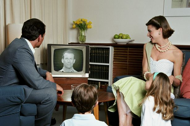 Parents+and+children+6-8+around+television+in+living+room